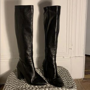 Black leather up to the knee boots